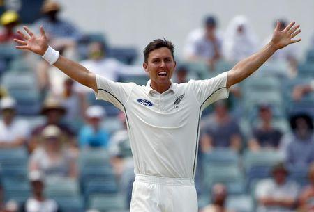 New Zealand's Trent Boult celebrates after he dismissed Australia's Adam Voges for 41 runs during the second day of the second cricket test match at the WACA ground in Perth, Western Australia