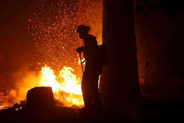 PHOTO: Firefighters extinguish hot spots as the Caldor Fire moves through the area on Aug. 30, 2021 near Twin Bridges, Calif.  (Justin Sullivan/Getty Images)
