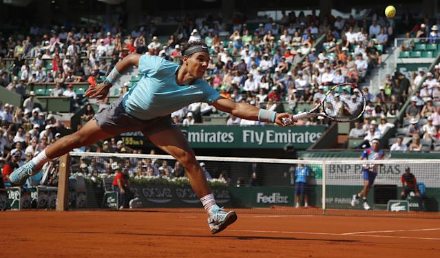 Spain's Rafael Nadal returns the ball during the third round match of the French Open tennis tournament against Argentina's Leonardo Mayer at the Roland Garros stadium, in Paris, France, Saturday, May 31, 2014. (AP Photo/Michel Euler)