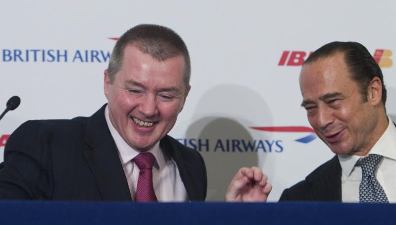 British Airway's Chief Executive Willie Walsh, left and Iberia's Chairman Antonio Vazquez share a light moment during a joint British Airways and Iberia news conference in Madrid Tuesday Nov. 30, 2010. The two airlines revealed in London and Madrid that more than 99 percent of investors had voted in favor of the merger, which the pair hope will help counter falling demand from both business and leisure travelers in the wake of the global credit squeeze.(AP Photo/Paul White)