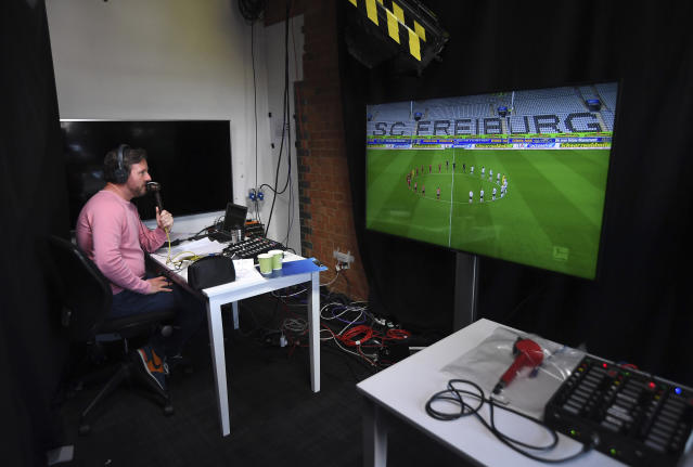 Soccer commentator Dan O'Hagan commentates on the German Bundesliga soccer match between Freiburg and Werder Bremen remotely from a studio in Camden Town, London, Saturday May 23, 2020. The Bundesliga is the only soccer major league to have resumed since the start of the coronavirus lockdown and with increased global demand matches are also being provided to customers with a commentary in English. (AP Photo/Alberto Pezzali)