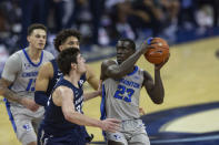 Creighton forward Damien Jefferson (23) drives to the basket against Xavier forward Zach Freemantle (32) in the second half during an NCAA college basketball game on Wednesday, Dec. 23, 2020, in Omaha, Neb. (AP Photo/John Peterson)