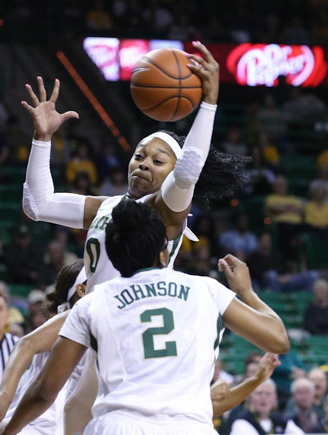 Baylor guard Odyssey Sims (0) pulls down a rebound over Iowa State while teammate guard Niya Johnson (2) looks on in the first half of an NCAA college basketball game, Wednesday, Feb. 19, 2014, in Waco, Texas. (AP Photo/Rod Aydelotte)
