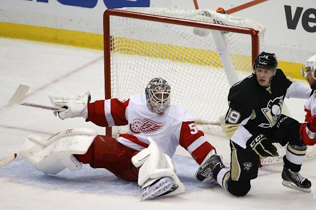 Detroit Red Wings goalie Jonas Gustavsson (50) gets up after colliding with Pittsburgh Penguins' Beau Bennett (19) during the first period of an NHL hockey game in Pittsburgh, Wednesday, April 9, 2014. (AP Photo/Gene J. Puskar)