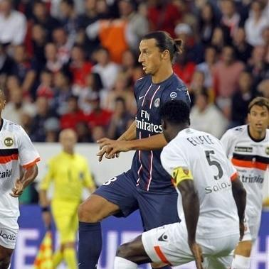 PSG's Zaltan Ibra Ibrahimovic controls the ball with Lorient's Bruno Ecuele Manga , left , during their French League One soccer match against Lorient, Saturday, Aug. 11, 2012, in Parc des princes stadium, in Paris, France. (AP Photo/Jacques Brinon)