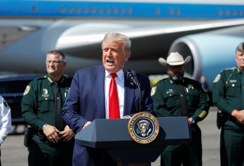 U.S. President Donald Trump speaks to supporters as he arrives in Tampa, Florida