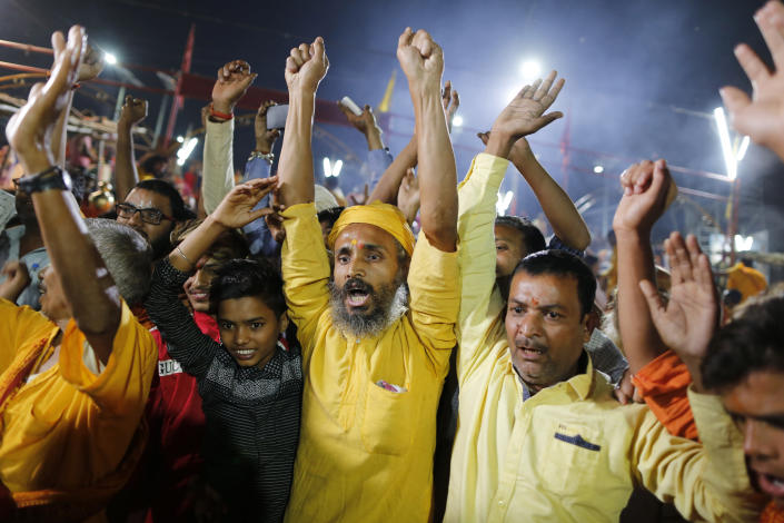 Hindu devotees celebrate the verdict in a decades-old land title dispute between Muslims and Hindus, in Ayodhya, India , Saturday, Nov. 9, 2019. India's Supreme Court on Saturday ruled in favor of a Hindu temple on a disputed religious ground and ordered that alternative land be given to Muslims to build a mosque. The dispute over land ownership has been one of the country's most contentious issues. (AP Photo/Rajesh Kumar Singh)