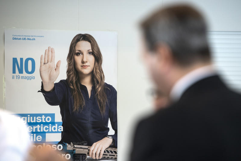 Meeting rooms and a poster of the committee against the EU gun laws and policies, prior to the committee's meeting in Burgdorf, Switzerland, Sunday, May 19, 2019. Swiss voters clearly accepted EU's stricter gun control at the national ballot. (Peter Schneider/Keystone via AP)
