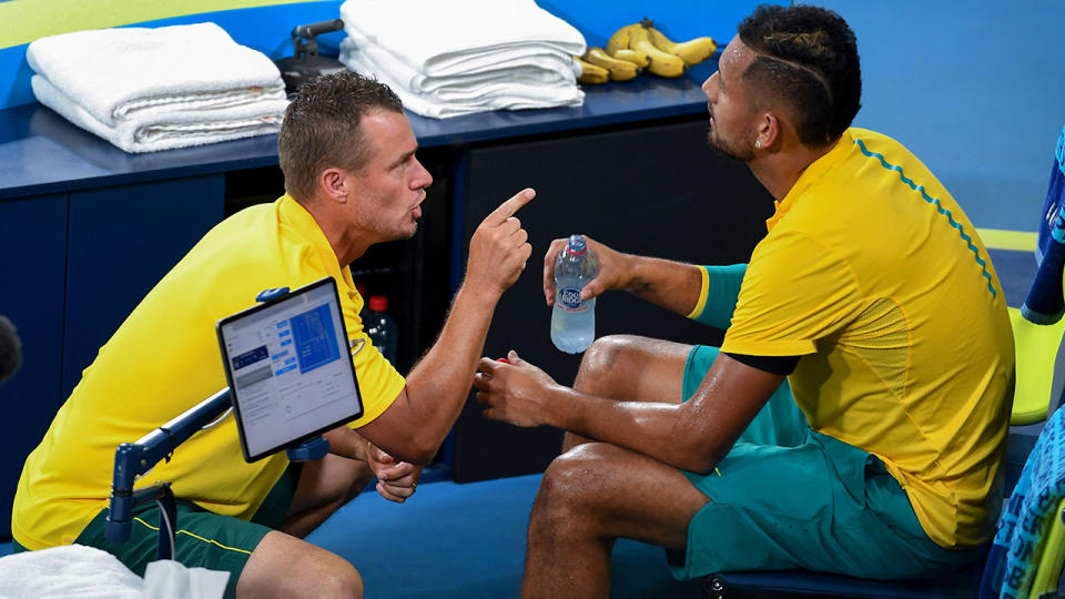 Lleyton Hewitt, pictured here speaking to Nick Kyrgios during his ATP Cup match.
