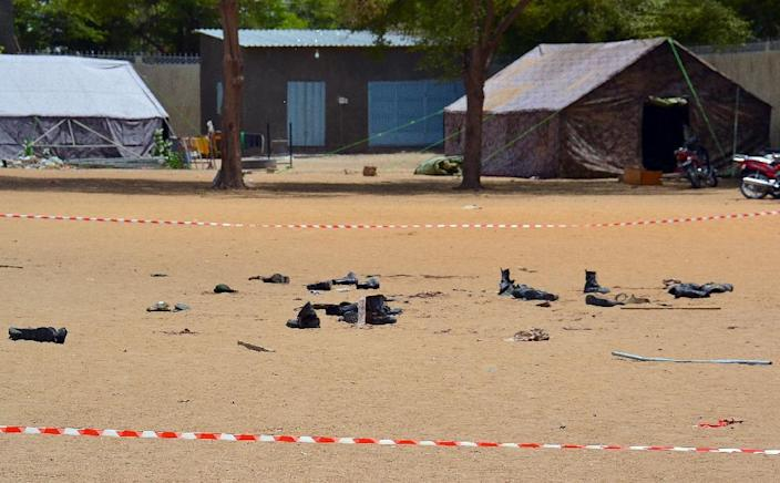 Boots of people killed in a suicide bomb attack outside the police headquarters in N'Djamena, on June 15, 2015 (AFP Photo/Brahim Adji)