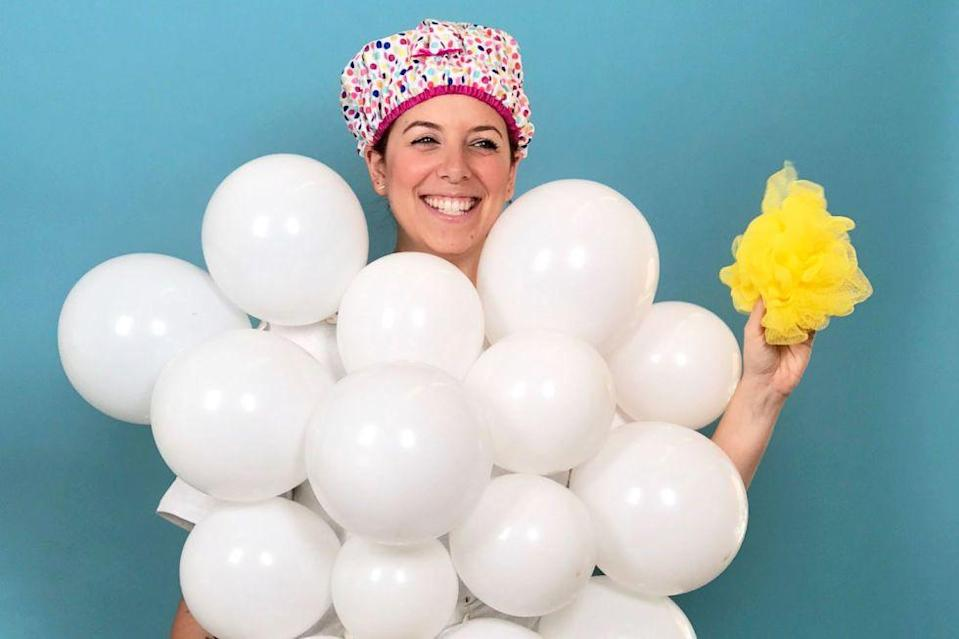 """<p>No water required! Safety-pin white balloons to a white tee and add a colorful shower cap. Get into character by taking a sudsy bath of your own before you get dressed.</p><p><a class=""""link rapid-noclick-resp"""" href=""""https://www.amazon.com/Elecrainbow-Thicken-Metallic-Pearlescent-Balloons/dp/B01GYQ0BYI/?tag=syn-yahoo-20&ascsubtag=%5Bartid%7C10055.g.2750%5Bsrc%7Cyahoo-us"""" rel=""""nofollow noopener"""" target=""""_blank"""" data-ylk=""""slk:SHOP WHITE BALLOONS"""">SHOP WHITE BALLOONS</a></p><p><a class=""""link rapid-noclick-resp"""" href=""""https://www.amazon.com/gp/product/B00KFR73NU/ref=od_aui_detailpages00?tag=syn-yahoo-20&ascsubtag=%5Bartid%7C10055.g.2750%5Bsrc%7Cyahoo-us"""" rel=""""nofollow noopener"""" target=""""_blank"""" data-ylk=""""slk:SHOP SHOWER CAPS"""">SHOP SHOWER CAPS</a> </p>"""