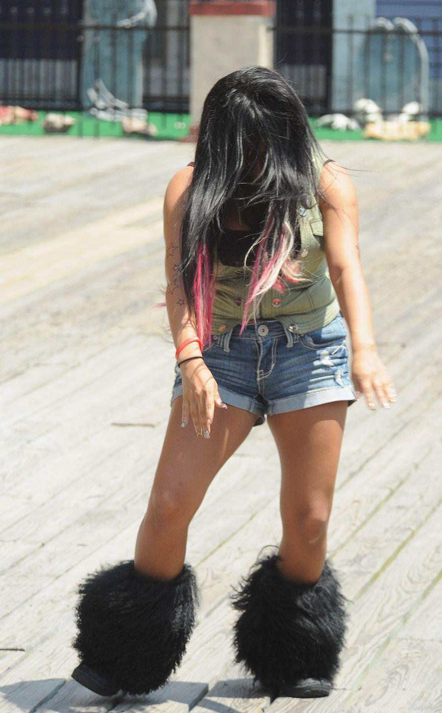<p>It just may have been Nicole Polizzi (better known as Snooki) from <em>Jersey Shore</em> who made huge furry boots popular—and hopefully they'll never make their way back onto a list of trends again. Not only did they make your feet and legs unnecessarily hot, but they just looked ridiculous! </p>