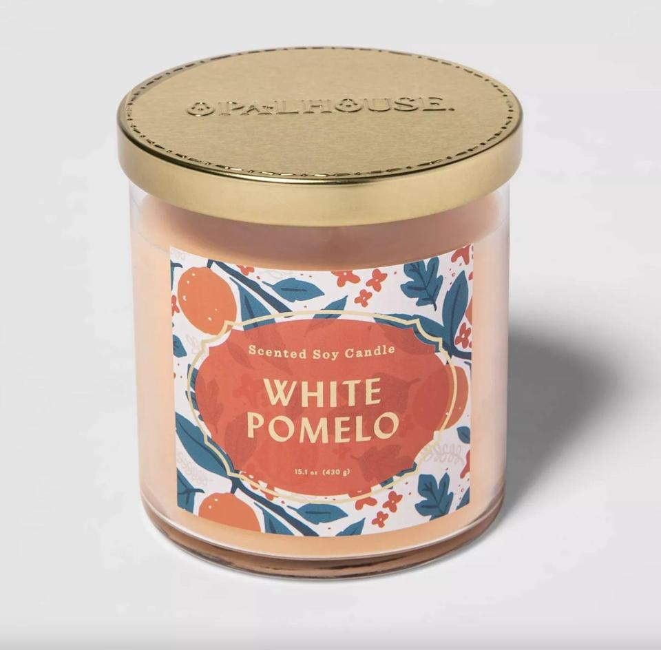 <p>This peach-colored <span>White Pomelo Lidded Glass Jar 2-Wick Candle</span> ($10) can burn for 50 hours. Enjoy!</p>