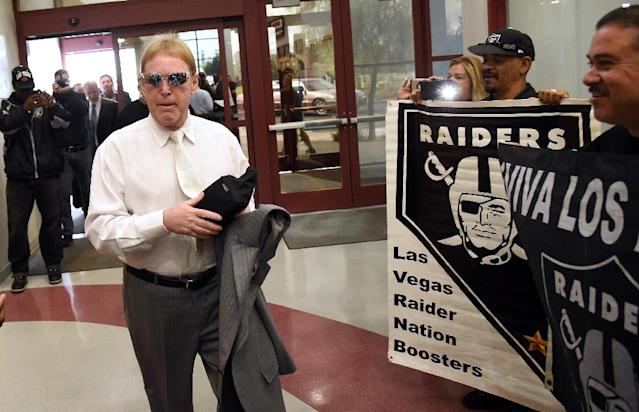 Oakland Raiders owner Mark Davis walks past fans holding Raiders signs as he arrives at a Southern Nevada Tourism Infrastructure Committee meeting at UNLV on April 28, 2016 in Las Vegas, Nevada (AFP Photo/Ethan Miller)