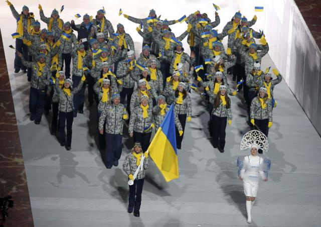 Ukraine's flag-bearer Valentina Shevchenko leads her country's contingent during the athletes' parade at the opening ceremony of the 2014 Sochi Winter Olympics, February 7, 2014. REUTERS/Lucy Nicholson (RUSSIA - Tags: OLYMPICS SPORT)