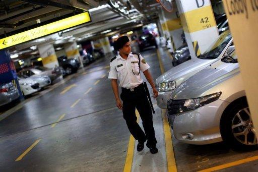 A security guard patrols the car park of a shopping mall in Kuala Lumpur on August 8. The fear of crime is soaring in Malaysia as personal tales of abduction, assault and robbery go viral online, upping pressure on authorities to respond and triggering scrutiny of official claims that offences are down