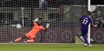 Orlando City forward Nani (17) scores the winning goal against Los Angeles FC goalkeeper Kenneth Vermeer (1) during a shootout of an MLS soccer match, Friday, July 31, 2020, in Orlando, Fla. (AP Photo/John Raoux)