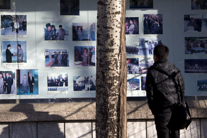 A man looks at photos of the late North Korean leader Kim Jong Il displayed outside North Korean embassy where a meeting of North Korean and U.S. diplomats is held, in Beijing, China, Thursday, Feb. 23, 2012. The U.S. and North Korea reopen nuclear talks on Thursday that will provide a glimpse into where Pyongyang's opaque government is heading after Kim Jong Il's death and test its readiness to dismantle nuclear programs for much-needed aid. (AP Photo/Alexander F. Yuan)