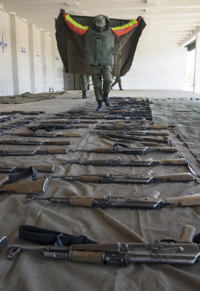 A soldier walks among assault rifles that were confiscated from the police after the military raided police installations on September 1, 2014, in Maseru, Lesotho (AFP Photo/Mujahid Safodien)