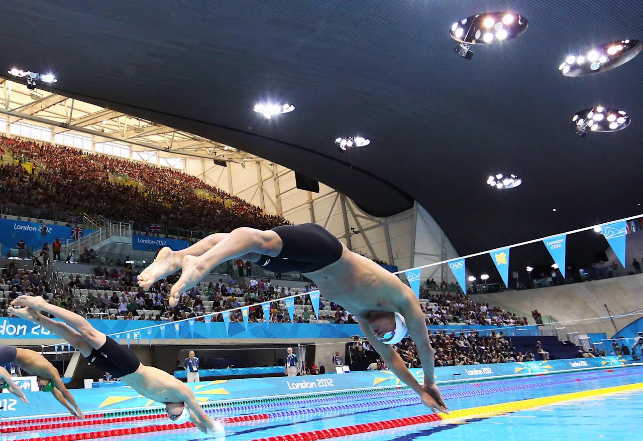 United States swimmer Ryan Lochte dives off of the starting block during the men's 400-meter individual medley event during the 2012 Summer Olympics at the Aquatics Centre in London on Saturday, July 28, 2012, in London. (AP Photo/Al Bello, Pool)