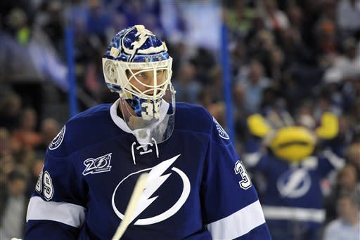 Tampa Bay Lightning goalie Anders Lindback takes a break from defending the goal during the third period of an NHL hockey game against the Toronto Maple Leafs on Tuesday, Feb. 19, 2013, in Tampa, Fla. (AP Photo/Brian Blanco)