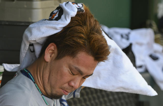 Los Angeles Dodgers starting pitcher Kenta Maeda (18) wipes his face in the dugout after being relieved during the fourth inning of a baseball game against the Chicago Cubs on Tuesday, June 19, 2018, in Chicago. (AP Photo/Matt Marton)