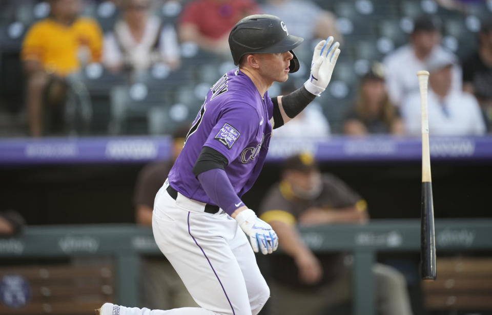 Colorado Rockies' Trevor Story follows the flight of his RBI-single off San Diego Padres starting pitcher Dinelson Lamet in the third inning of a baseball game Monday, June 14, 2021, in Denver. (AP Photo/David Zalubowski)