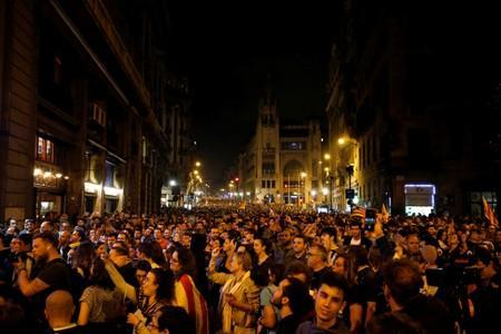 Demonstrators attend a protest after a verdict in a trial over a banned independence referendum, in Barcelona