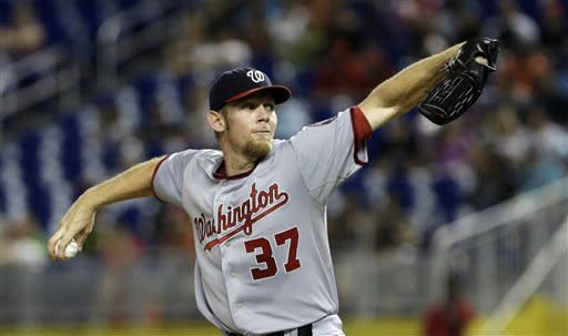 Washington Nationals' Stephen Strasburg pitches against the Miami Marlins in the first inning of a baseball game, Friday, July 12, 2013, in Miami. (AP Photo/Alan Diaz)