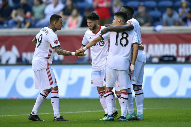 Toronto FC players celebrate Jonathan Osorio's winning goal against the Chicago Fire on Saturday. (Getty)