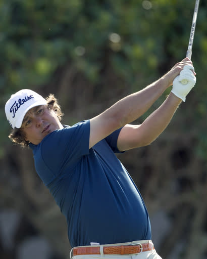 Jason Dufner tees off on the first tee box during the final round of the Tournament of Champions golf tournament, Monday, Jan. 6, 2014, in Kapalua, Hawaii. (AP Photo/Marco Garcia)