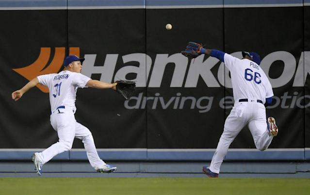 Joc Pederson and Yasiel Puig moments before violently colliding with each other. (AP)
