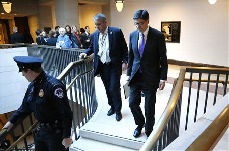 U.S. Treasury Secretary Jack Lew (R) arrives to brief members of the U.S. Senate on talks with Iran during a closed-door meeting at the Capitol in Washington, December 11, 2013. REUTERS/Jonathan Ernst