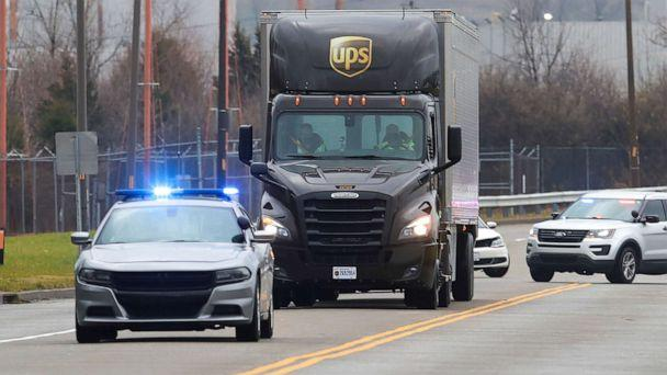 PHOTO: Kentucky State Police escort a UPS truck carrying Moderna's COVID-19 vaccine as it arrives at UPS Worldport, in Louisville, Dec. 20, 2020. (Michael Clevenger/Pool via Reuters)