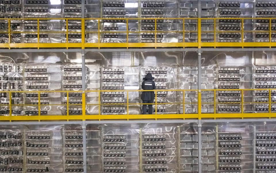 A data centre operated by BitRiver, a company providing services for cryptocurrency mining in the city of Bratsk in Russia - MAXIM SHEMETOV/Reuters