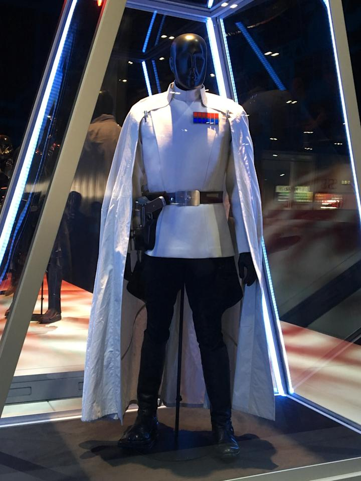 "<p>The Imperial operative clearly favors the dark side of the force, but the ""cruel but brilliant"" Krennic (Ben Mendelsohn) will attempt to squash the Rebellion in pristine white wool. Dig that amazing cape.<br /></p>"
