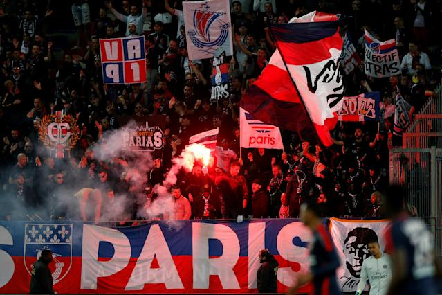 Soccer Football - Ligue 1 - Caen vs Paris St Germain - Stade Michel d'Ornano, Caen, France - May 19, 2018 Paris Saint-Germain fan sets off a flare in the stands during the match REUTERS/Pascal Rossignol