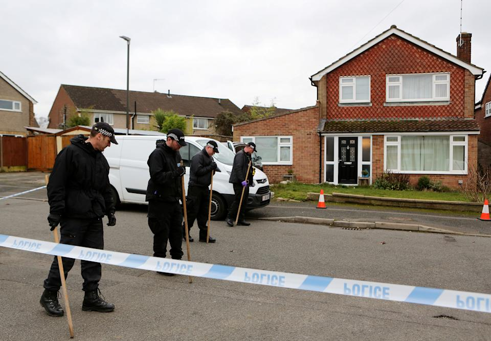 Police investigate at the scene of the double murder. (Anita Maric/SWNS)