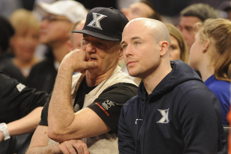 Murray with his son, Luke, who is an assistant basketball coach at Xavier University. (Mitchell Layton via Getty Images)