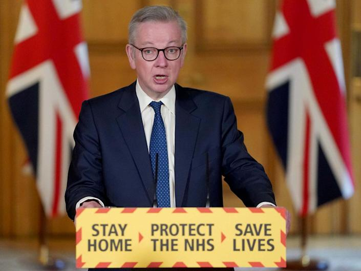 Michael Gove holds the daily Covid-19 news conference on Sunday where he warned the public could not expect a rapid return to 'normal' life: Reuters