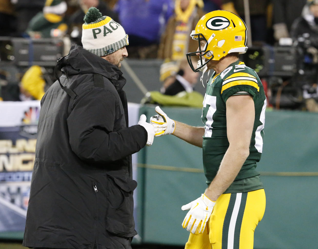 Green Bay Packers' Aaron Rodgers shakes hands with Jordy Nelson before an NFL football game against the Minnesota Vikings Saturday, Dec. 23, 2017, in Green Bay, Wis. (AP Photo/Mike Roemer)