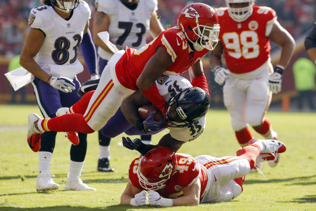 <p>Baltimore Ravens running back Gus Edwards (35) is tackled by Kansas City Chiefs cornerback Kendall Fuller (23) and defensive back Daniel Sorensen (49) during the first half of an NFL football game in Kansas City, Mo., Sunday, Dec. 9, 2018. (AP Photo/Charlie Riedel) </p>