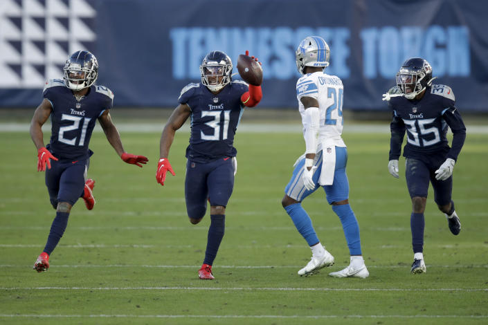Tennessee Titans free safety Kevin Byard (31) celebrates after scoring against the Detroit Lions during the second half of an NFL football game Sunday, Dec. 20, 2020, in Nashville, N.C. (AP Photo/Ben Margot)
