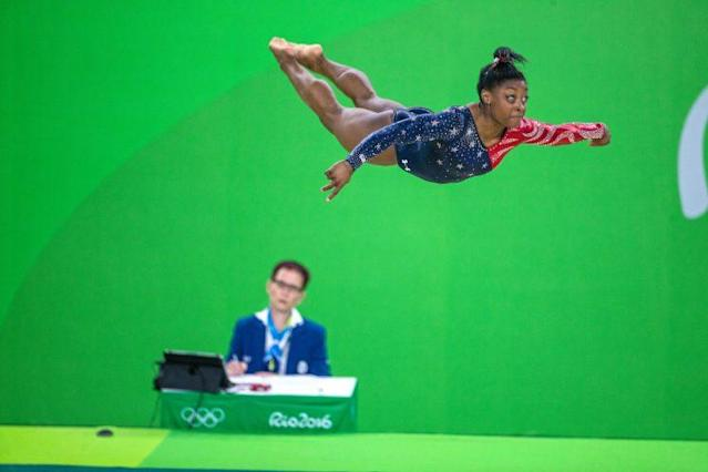 "<a class=""link rapid-noclick-resp"" href=""/olympics/rio-2016/a/1112764/"" data-ylk=""slk:Simone Biles"">Simone Biles</a> performing her floor routine during the Women's Qualification round (Getty Images)"