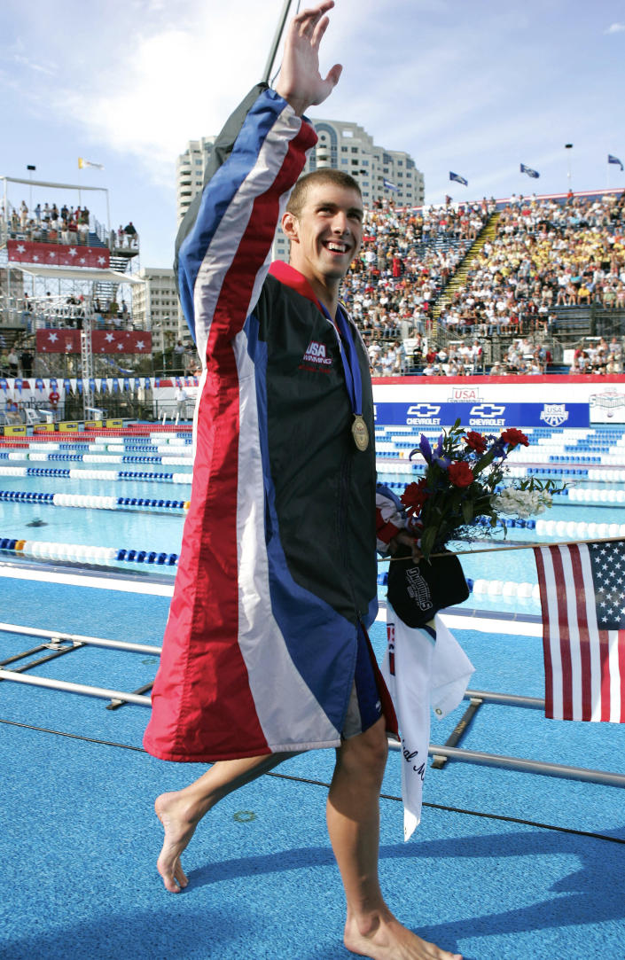 FILE - In this July 7, 2004, file photo, Michael Phelps celebrates after breaking his own world record in the 400-meter individual medley with a time of four minutes, 8.41 seconds at the U.S. Olympic swimming trials in Long Beach, Calif. For the first time since 1996, the U.S. Olympic swimming trials are being held without Phelps, the sport's biggest star, the guy who won a staggering 23 gold medals and 28 medals overall at the Olympics. (AP Photo/Mark J. Terrill, File)