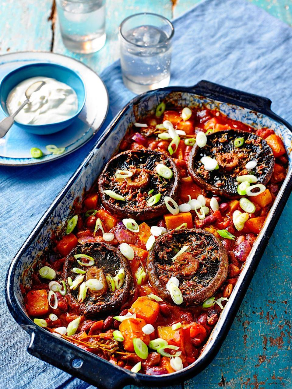 """<p>Swap the butternut squash for sweet potato, if you prefer. You could also add extra veg to the beans to bulk out the dish to serve more – peppers or diced aubergine would be delicious.</p><p><strong>Recipe: <a href=""""https://www.goodhousekeeping.com/uk/food/recipes/a29205109/portobello-mushroom-traybake/"""" rel=""""nofollow noopener"""" target=""""_blank"""" data-ylk=""""slk:Baked Portobello mushrooms on Smoky Beans Traybake"""" class=""""link rapid-noclick-resp"""">Baked Portobello mushrooms on Smoky Beans Traybake</a></strong></p>"""