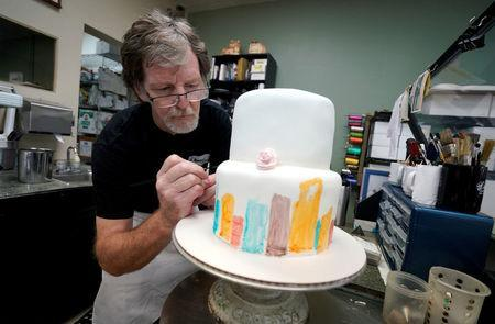 FILE PHOTO: Baker, Jack Phillips, decorates a cake in his Masterpiece Cakeshop in Lakewood, Colorado U.S., on September 21, 2017. REUTERS/Rick Wilking/File Photo