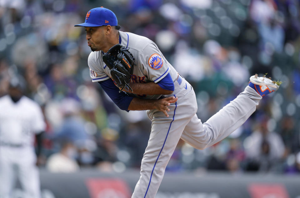 New York Mets relief pitcher Edwin Diaz works against the Colorado Rockies in the ninth inning of a baseball game Sunday, April 18, 2021, in Denver. (AP Photo/David Zalubowski)