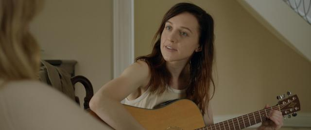 Lena Hall gives a guitar lesson in <em>Becks</em>. (Photo: Blue Fox Entertainment)