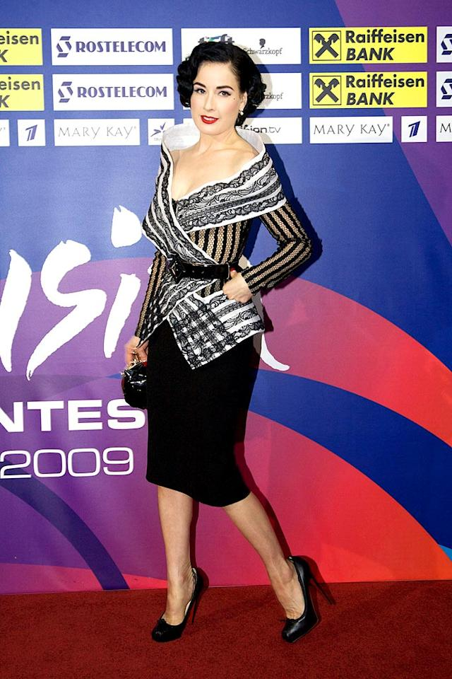"""Burlesque beauty Dita Von Teese once again channeled Old Hollywood glamor by rocking a gorgeous Jean Paul Gaultier Couture skirt suit and black Louboutins while out and about in Moscow. Oleg Nikishin/<a href=""""http://www.gettyimages.com/"""" target=""""new"""">GettyImages.com</a> - May 15, 2009"""